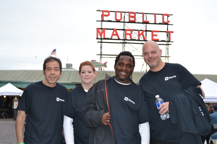 A team of Millionair Club Charity workers at a recent event at Pike Place Market.