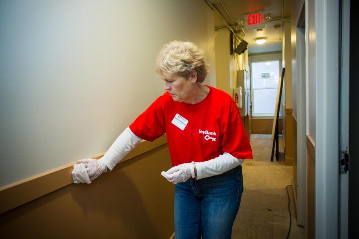 Volunteer Nancy Christenson cleans a hallway in the Kasota building. (Photo by Dan DeLong)