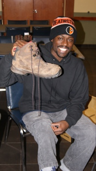 Norquan holds up shoe.JPG