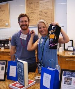 Volunteer Nick and MCC staff Chris displaying the great prizes for the drawing