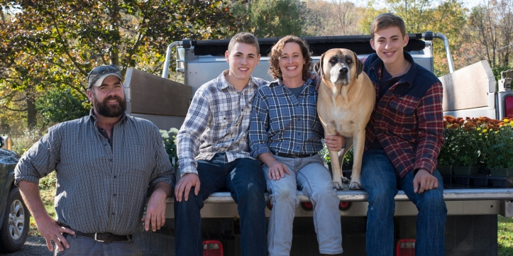 Group photo of Abi with her husband, two sons and dog Arlo.